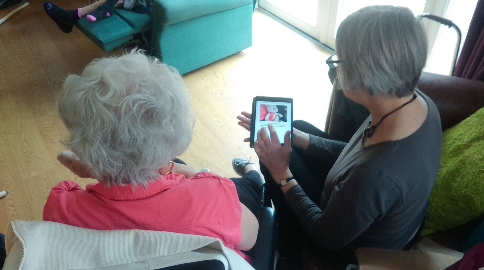 Volunteers working with Life Story Work Tool at Care home